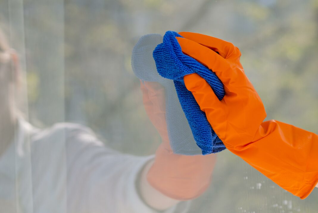 close-up-cleaning-window-with-cloth